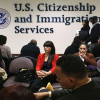 Immigrants wait for their citizenship interviews at the U.S. Citizenship and Immigration Services (USCIS), district office on January 29, 2013 in New York City. (Photo by John Moore/Getty Images)