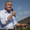 Jeb Bush, former governor of Florida and 2016 Republican presidential candidate, speaks to attendees at the Iowa State Fair Soapbox in Des Moines, Iowa, U.S., on Friday, Aug. 14, 2015. Sampling a fried Snickers bar and sidestepping a few hecklers, Bush made his way through the Iowa State Fair on Friday as he tried, and at times showed signs of struggling, to present himself as a fresh voice in the Republican presidential field. Photographer: Andrew Harrer/Bloomberg via Getty Images