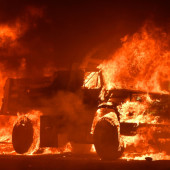 A truck burns as fire ravages the Napa wine region in California on October 9, 2017, as multiple wind-driven fires continue to whip through the region. (JOSH EDELSON/AFP/Getty Images)