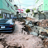 epa07000036 A mud covered car sits in the middle of a destroyed street following a powerful earthquake in Sapporo, Hokkaido, northern Japan, 06 September 2018. According to the Japan Meteorological Agency, a strong earthquake of 6.7 magnitude jolted JapanA¡Ëa?¡þa?¡Ës northern island of Hokkaido in the early hours of 06 September causing large landslides and blackouts. A blackout over Hokkaido is affecting almost 3 million households.  EPA/JIJI PRESS JAPAN OUT EDITORIAL USE ONLY/  NO ARCHIVES
